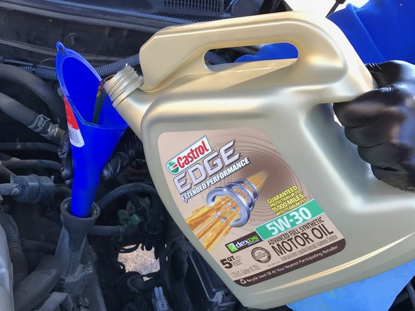 Image 1/2: Consult your owner's manual if you think your operating conditions call for a different oil viscosity.