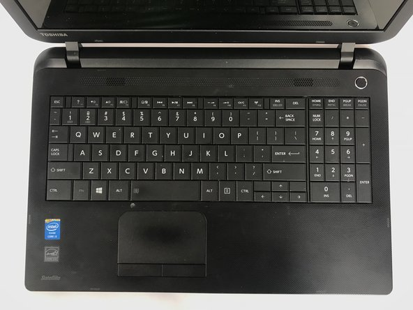 You should hear a click indicating the key has attached to its clip on the keyboard