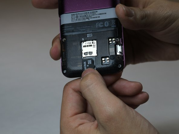 Put your new SD card in the casing, making sure that it is facing the correct way, as shown in the photos.