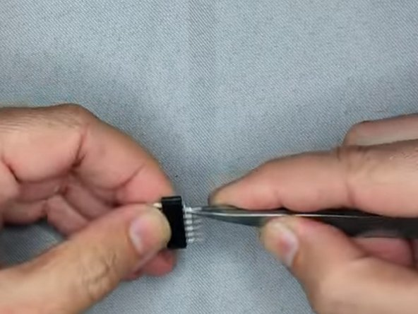 Bend the pins outwards