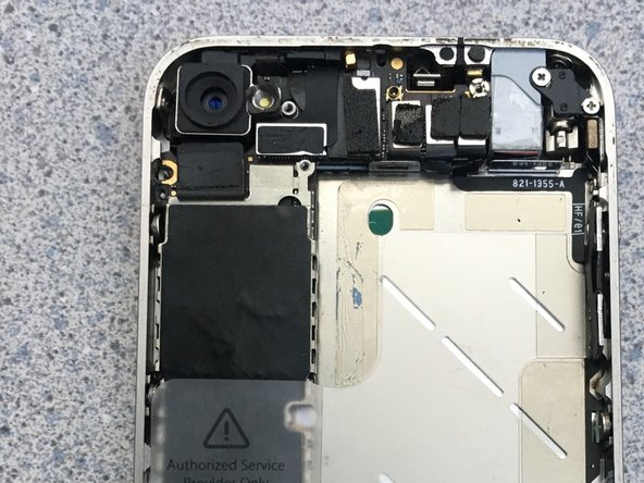 5. For the final step of this teardown unscrew a screw near the camera, then use the pry to carefully remove the camera