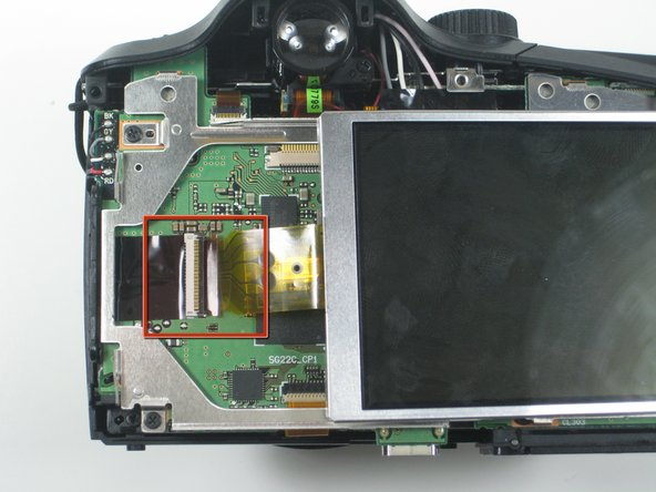 To completely remove the LCD screen from the interior of the camera, you must unhook the ribbon from the logic board.