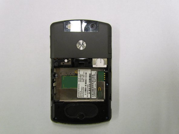 Insert the new SIM card into the card reader with the chamfered edge in the upper left corner.