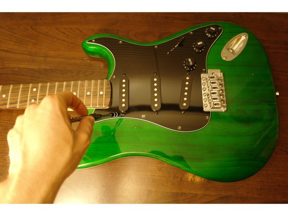 Image 1/1: With a screwdriver, unscrew the pickups.