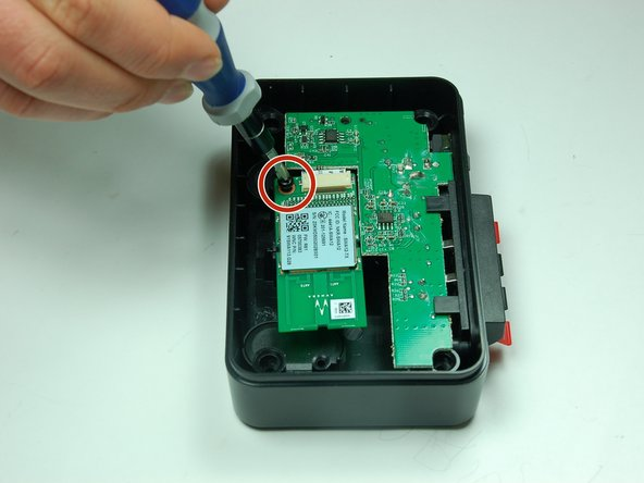 Use a Phillips #1 screwdriver to unscrew the 10 mm screw, securing the wireless audio module chip.