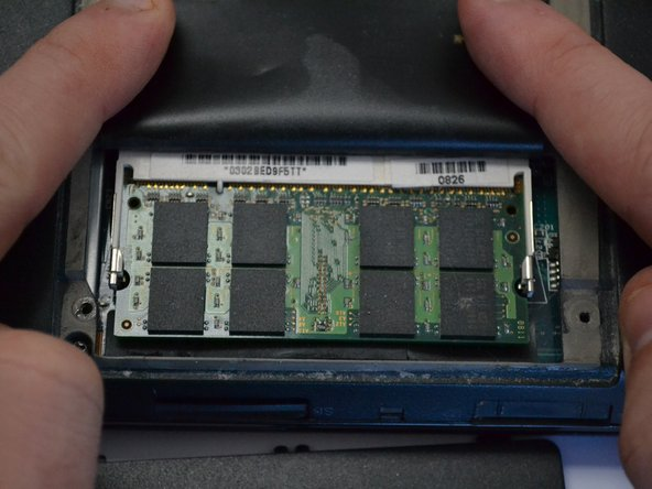 Lift the thin black plastic cover to access the RAM.