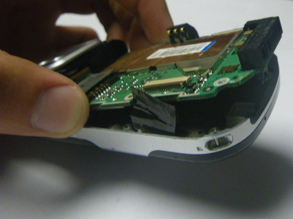 Separate the logic board from the case by lifting and pulling out the bottom.