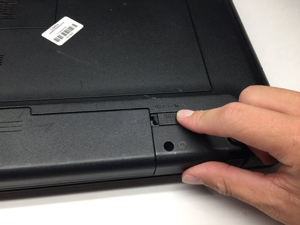 Simultaneously slide the latch on the left outwards while pulling the battery towards you.