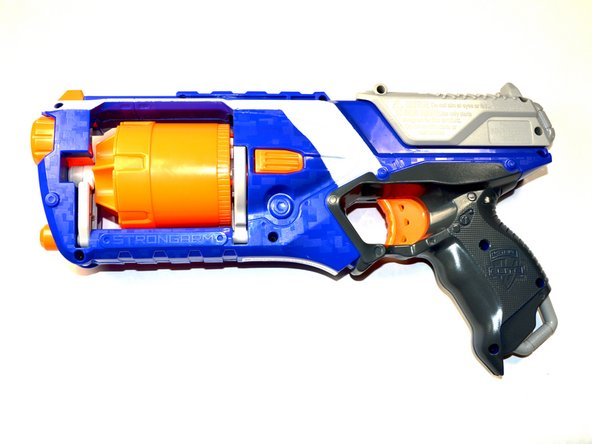 Lay the Nerf Strongarm on its side, left side facing up.