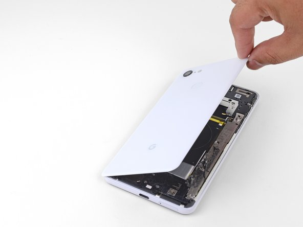 Swing the right edge of the back panel upwards and rest the flipped panel along the left side of the phone.