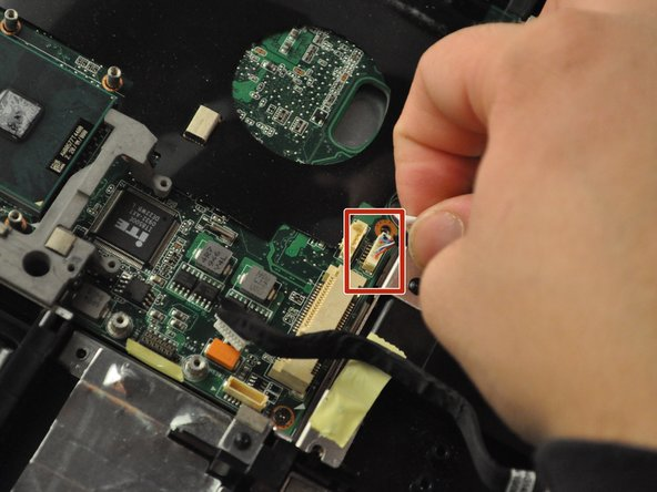 Unplug the wire cable in the central area of the laptop.