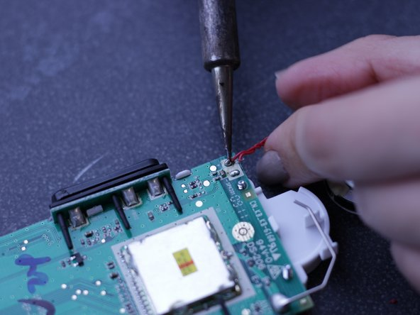 When the solder is fluid, carefully pull the electric wire loose.