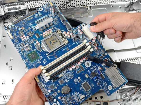 Attached to the power supply by an ATX connector, the motherboard is easier to remove than most logic boards.