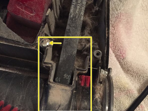 Image 1/2: Remove the brush by lifting straight up on both sides and the belt can be removed at the same time.