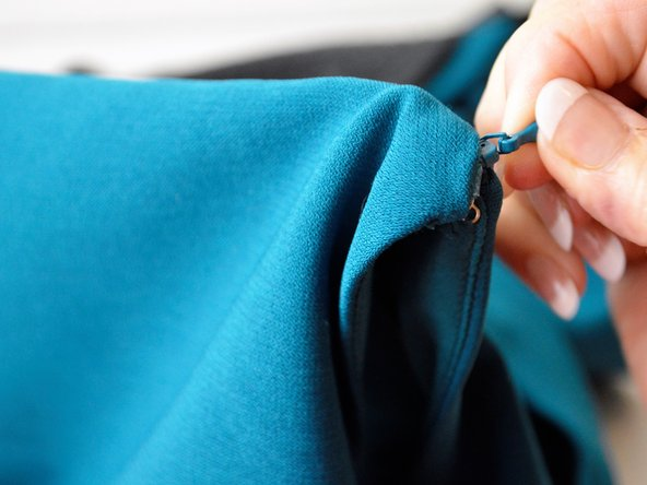Zip up the garmet to make sure everything is working properly.