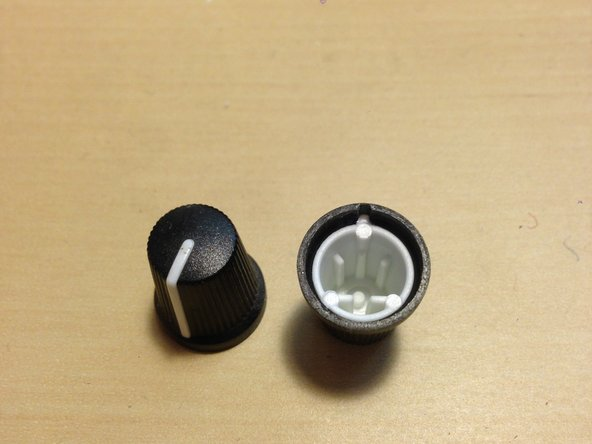 Remove knobs from the potentiometers by gripping firmly and pulling away from the chassis.