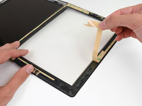 Peel the brown backing up off each adhesive strip.