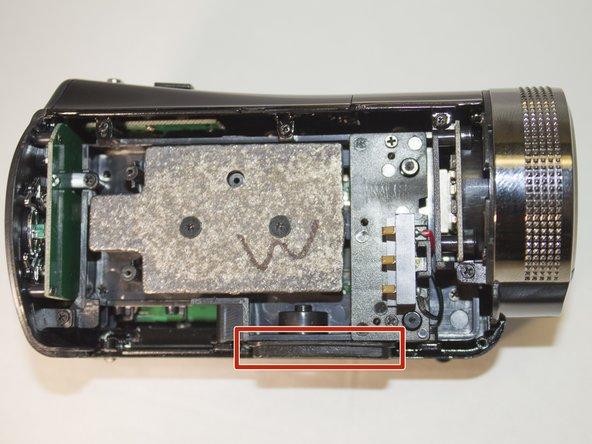 Apply pressure upwards to remove the tripod clip.