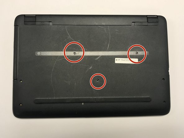 Remove the back of the laptop by unscrewing the screws shown.