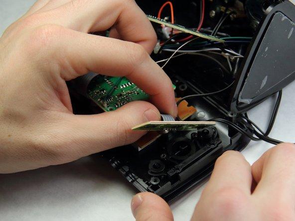 Remove the mini circuit board.