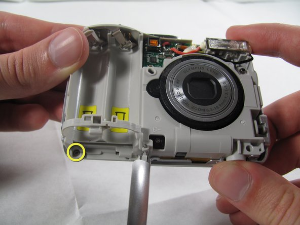 Remove the 3.2 mm screw in the battery compartment using a #00 screwdriver.