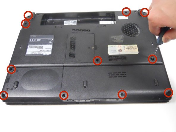 Image 1/1: Remove all the 6.6 mm type-00 Phillips head screws along the perimeter and in the center of the laptop.