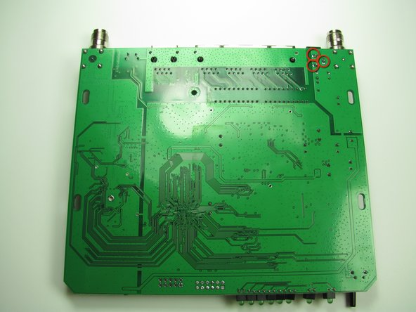 Turn the circuit board over and identify the solder connections you will desolder.