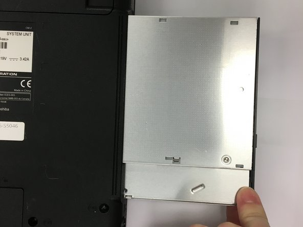 Image 2/2: The optical drive should pop out on the right side, and you can gently pull it out.
