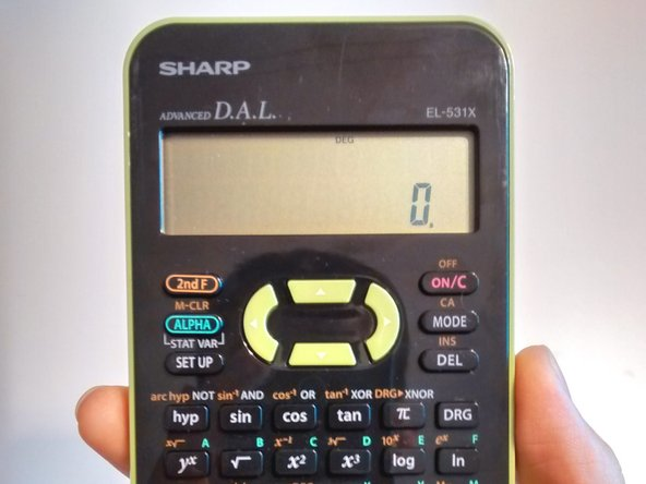 Hold the calculator in the palm of your hand with the display and keyboard facing up.