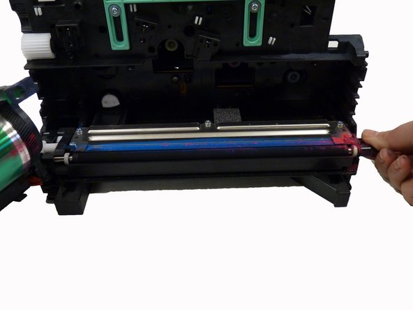 Keep toner rollers level to avoid toner spillage.