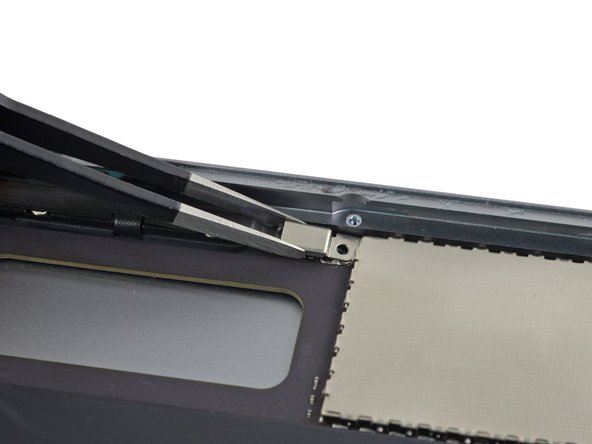Remove the case button cable bracket from the iPad.