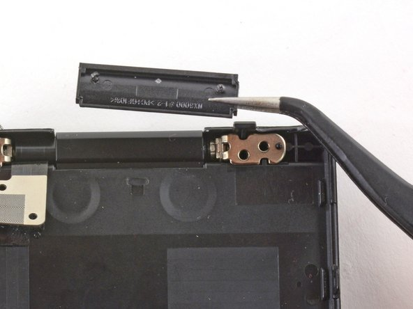 Use tweezers to remove the plastic cover on the LCD hinge.