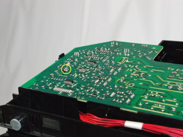 "Using a Phillips screwdriver, remove the, 1"", Phillips, PH#2 screw attaching the circuit board to the printer."