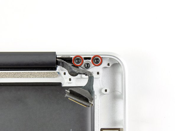 Image 1/1: We purposely have you leave one screw attaching the display to the upper case to aid in future steps.