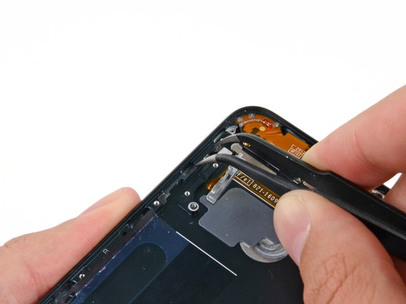 Use tweezers to remove the volume-up button from the iPod.