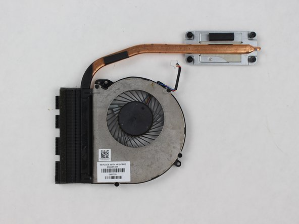 Once you have placed your thermal paste on the hot plate, take your replacement fan and place it back where the old fan was. To reassemble your laptop, follow these steps in reverse order.