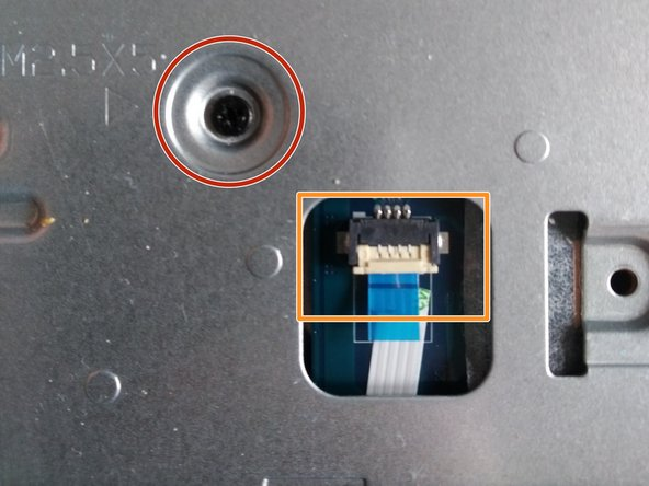 Remove the screw, and remove the ribbon cable from the connector.