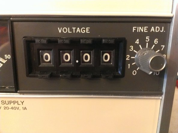This first image shows how you adjust the output voltage. You push the button above the number to raise the digit and the button below it to lower it. Including the fine adjustment potentiometer on the right this provides you with 5 significant figures of control.