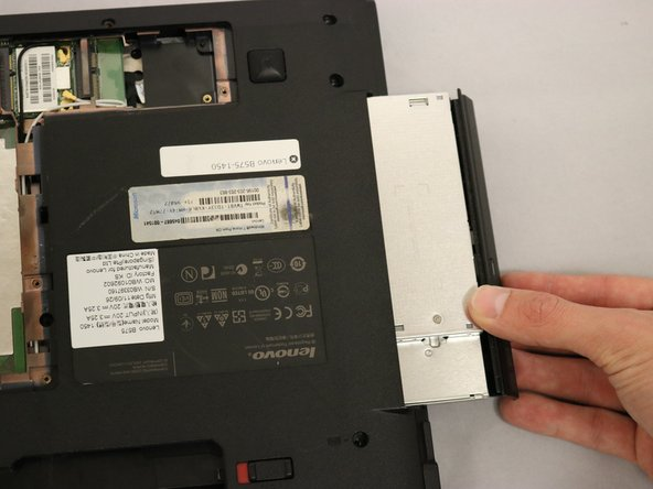 Pull the CD-ROM drive the rest of the way out.