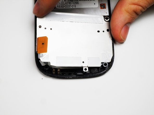Image 2/3: You can now peel off the keyboard, and replace it. After the new keyboard is in place, reassemble the device.