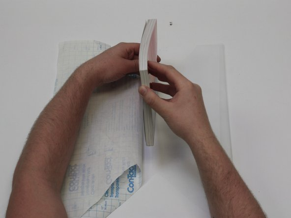 Place the top edge of your book to the top edge of the center of the laminate film.