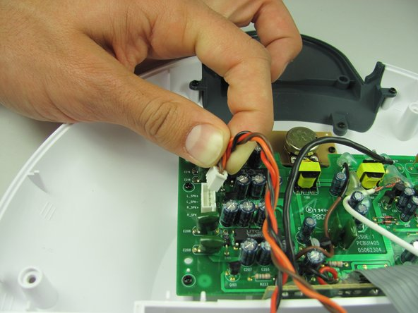 Image 2/2: Wiggling the connector back and forth as you pull will make removal easier.