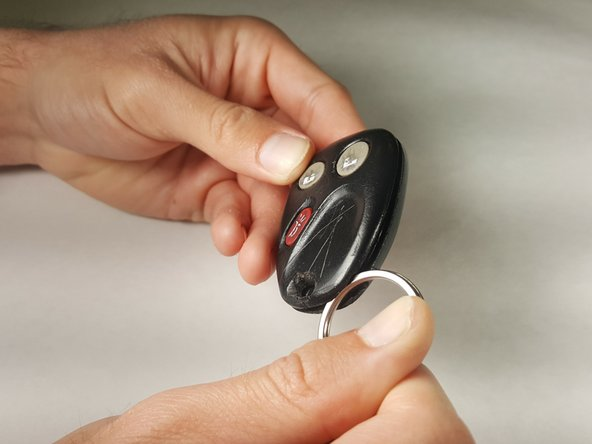 Once you have removed the key ring,  use it to open the housing by wedging it into the groove, as pictured.