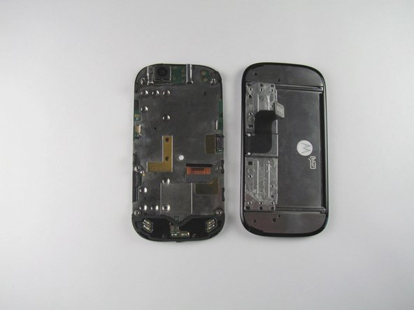 Grab the display flex cable and gently push it through the notch it is coming out of.