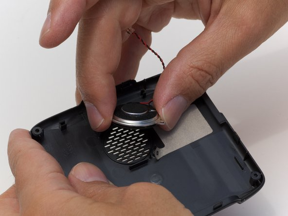 Once the speaker has been unscrewed, remove the speaker from the back casing with your fingers.