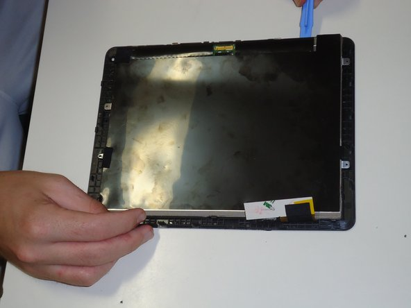 After all the screws are off, gently pry the screen from the black frame surrounding it again using your prying tool working clockwise until screen is detached from frame