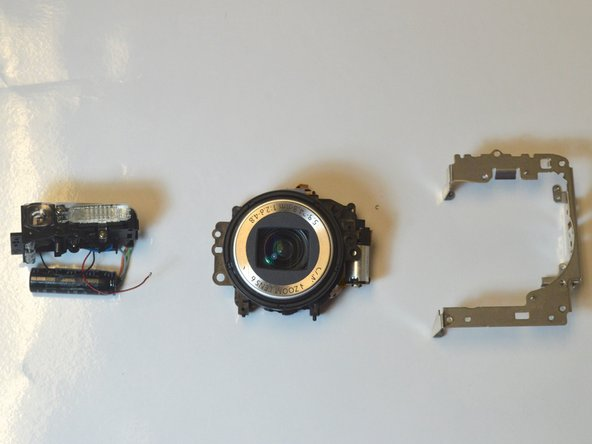 Now, the flash assembly and metal frame are  easily pulled away from the lens.