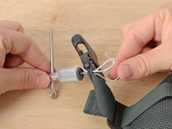 Image 1/3: Clip the end of the thread that runs through the needle, leaving enough length to tie a couple of knots.
