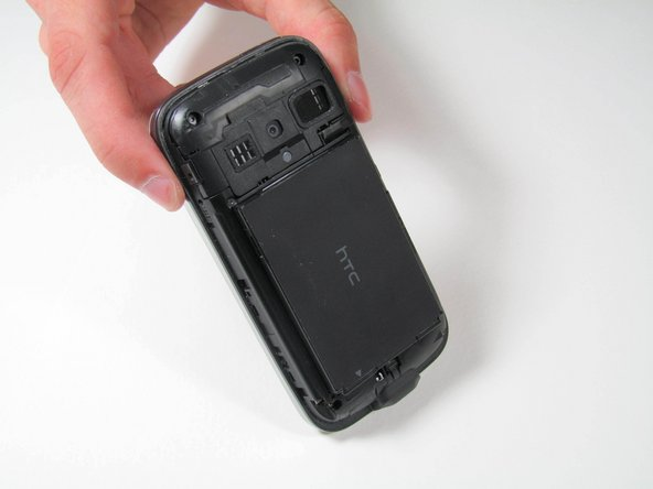 Remove the battery by pulling it away from the back of the phone.