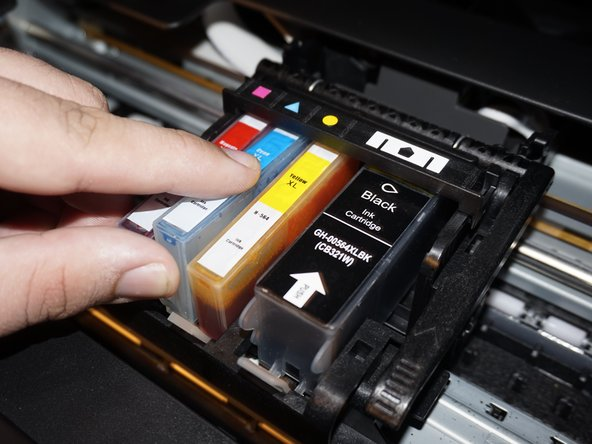 Image 2/3: Once the old ink cartridge(s) have been removed, open your new ink cartridge(s) and install the replacement ink cartridge. Push down by the locking tab to ensure the ink cartridge is securely installed.